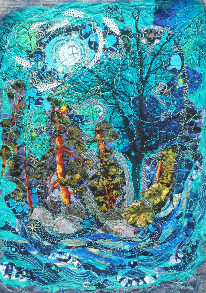 Textile art by Rachel Ryan showing trees surrounded by blue.