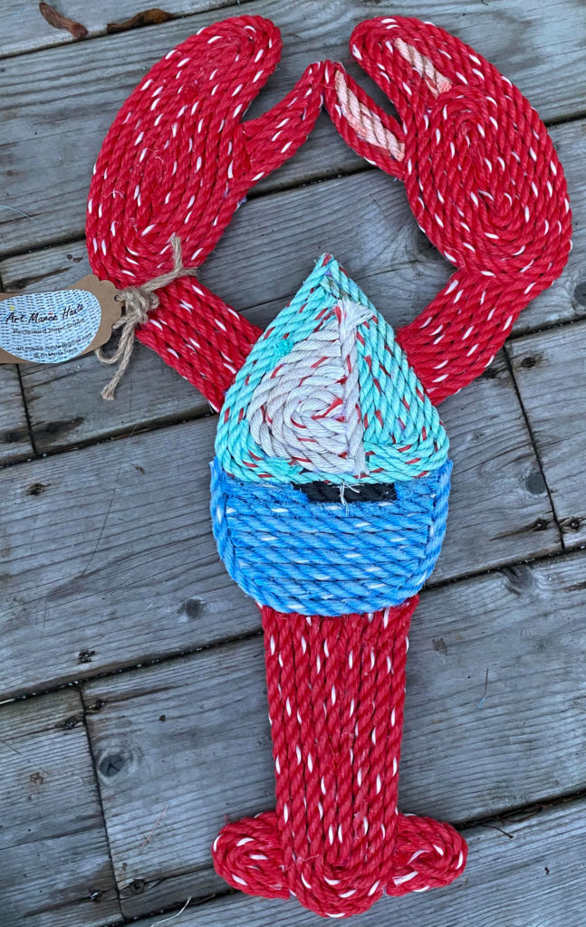 photo of lobster-shaped mat made from fishing rope