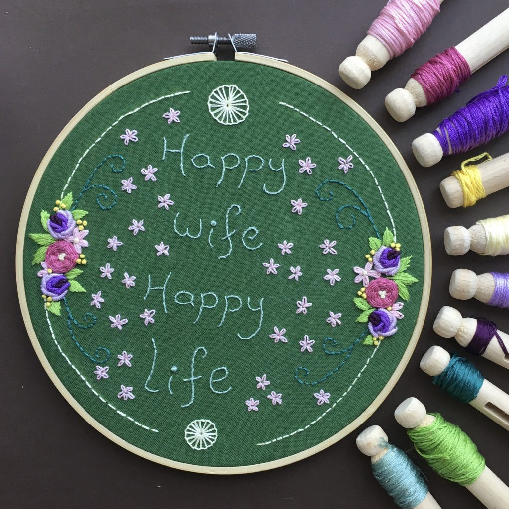 Embroidery by Natalia Tjiang with the words Happy Wife, Happy Life