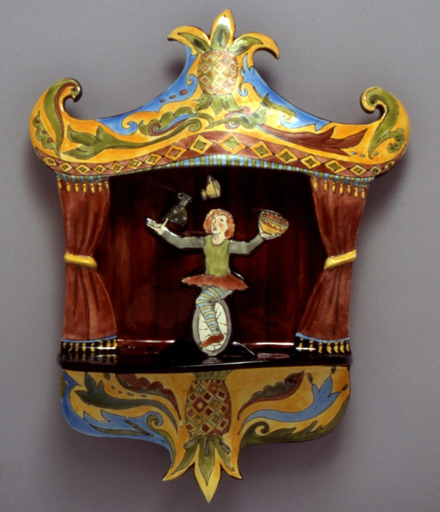 Ceramic sculpture by Teresa Bergen showing a juggling unicyclist on stage.